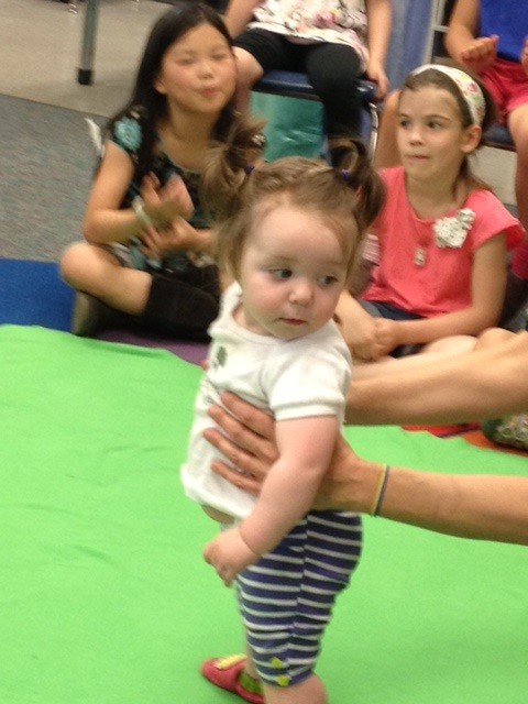 Baby Stella looks around at her second-grade friends at her last Roots of Empathy class