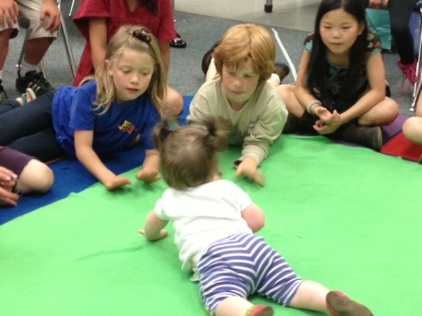 Second graders interacting with a baby in a Seattle Roots of Empathy session.