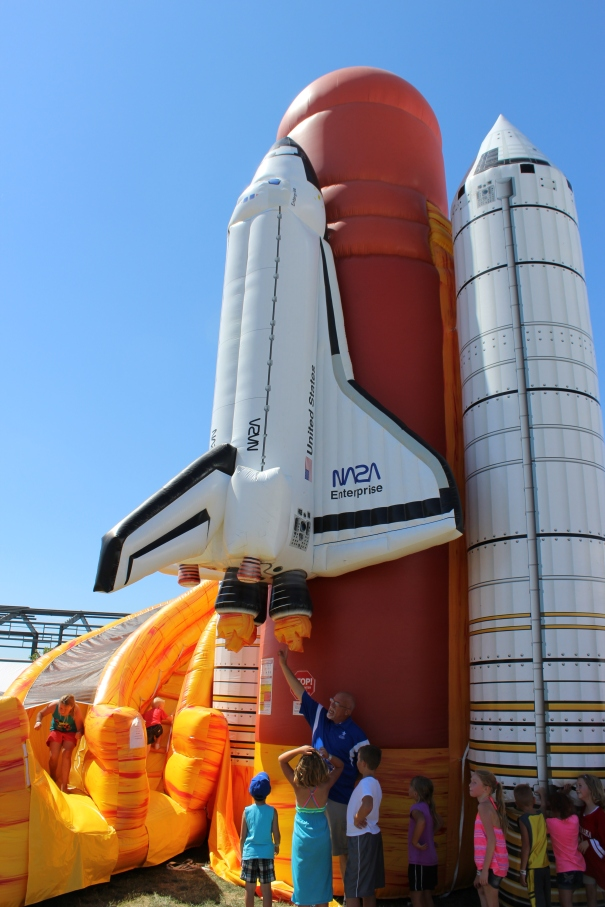 Kids come to learn about what makes a space shuttle work while enjoying a bounce house provided by the Strategic Air and Space Museum.