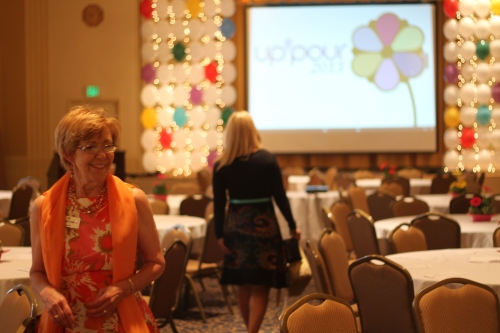 NCFF's Joanne Harse prepares to greet guests under the custom-created balloon curtain.