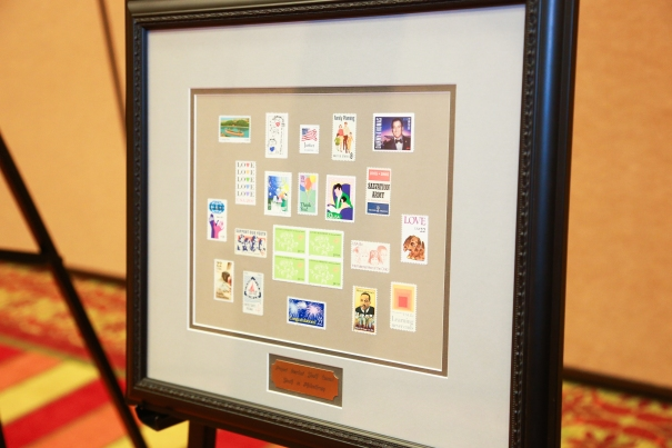 The award was an artful arrangement of postage stamps representing the group's interests.