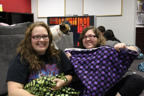 Brittany and Sierra showing off their handiwork (with a little help from the pooch perched on her shoulder)
