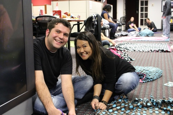 PE Lincoln Youth Advisor James Bowers and Employment Manager Oanh Heiser stop working to cheese it up.