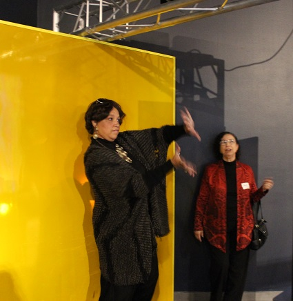 NET's Martha Florence dances in front of a motion sensing screen.