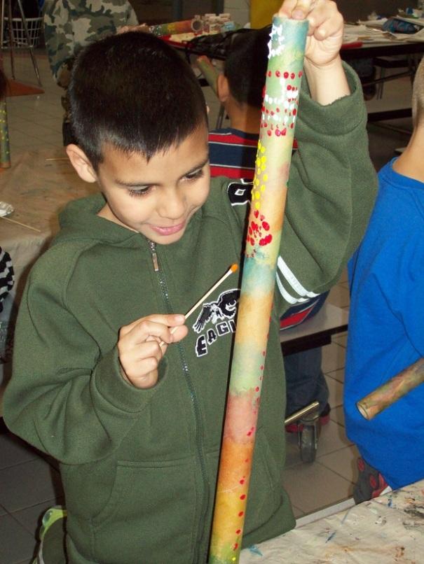 Student in Crete creating his own Didgeridoo.