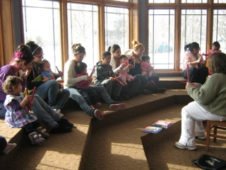 Group of young parents learning about healthy interactions with their babies.