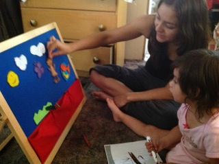 A young mother showing her skills as her child's most important teacher.