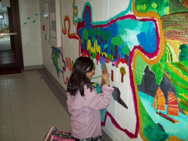 Painting a mural at the Crete ELO program