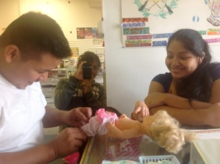 A young couple learning infant care skills.