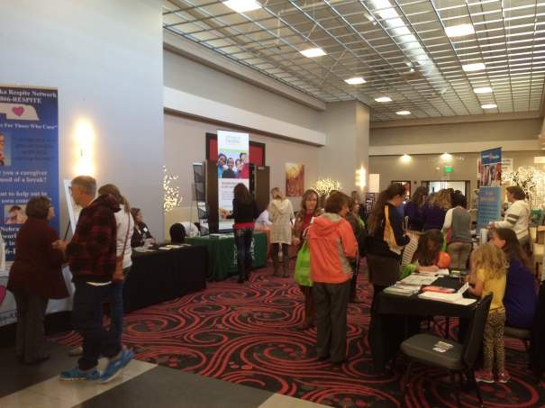 Attendees enjoy the resource walk, with more than 20 informational booths.