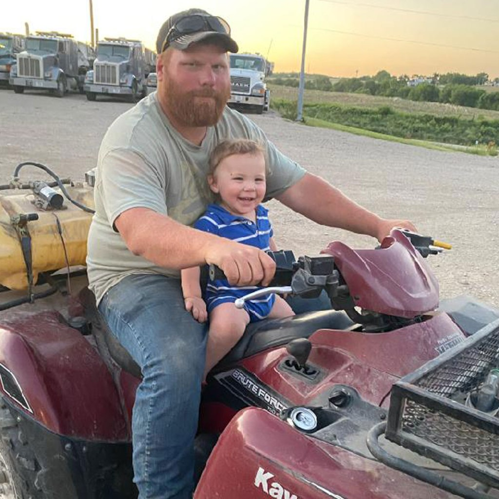 Taylor Boyle gets ready to go for a ride with his little one.