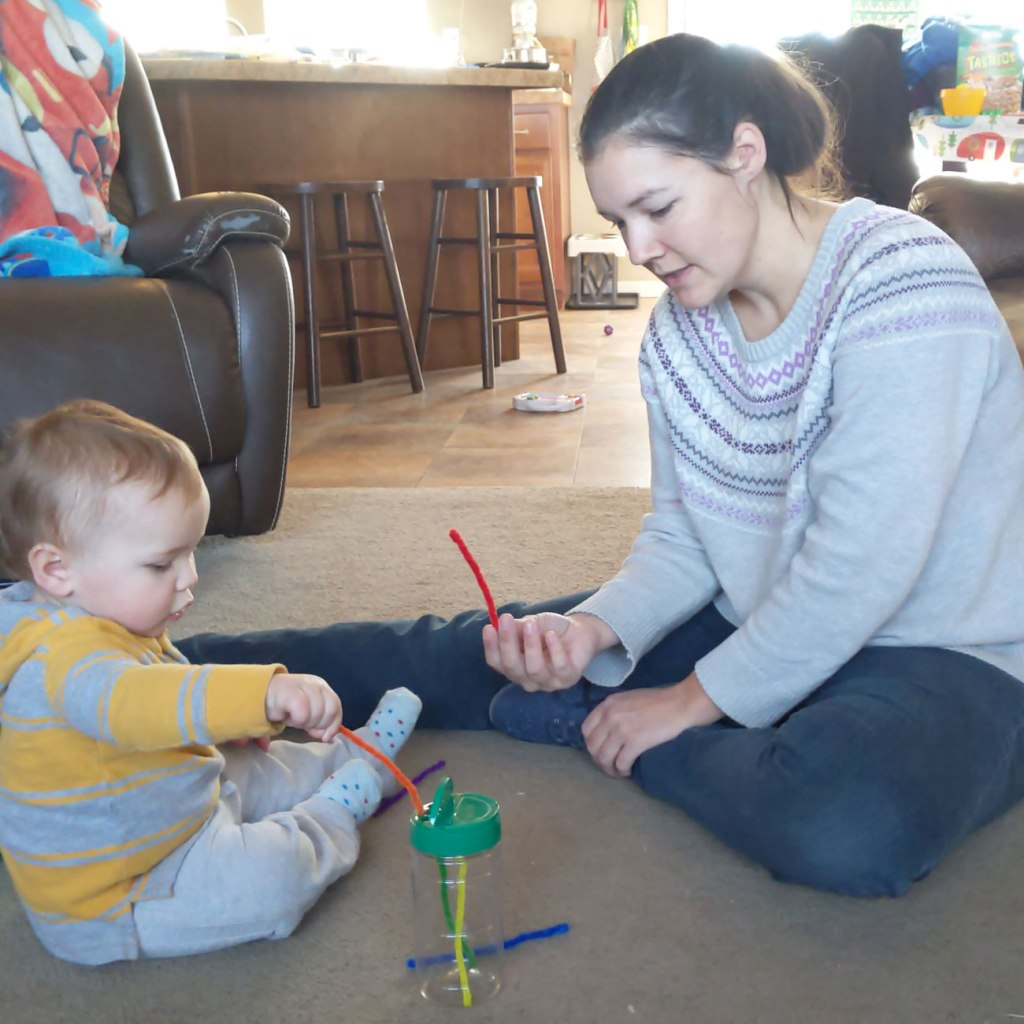 Cassie Boyle, (right), plays with her baby.