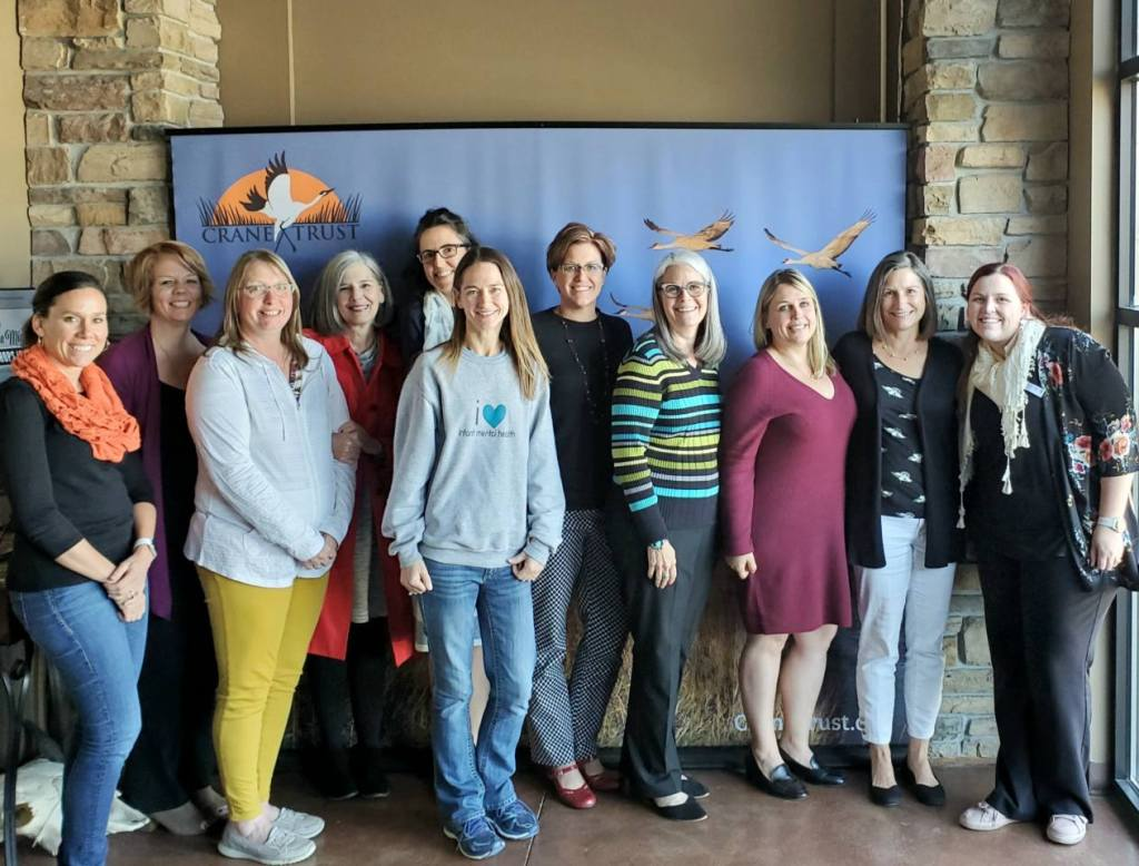 Here are the attendees, some of whom include representatives from Nebraska Children's Early Childhood initiative. This includes (from left to right), Sami Bradley (in the center), Lynne Brehm (in stripes), and Nikki Roseberry-Keiser (far right).