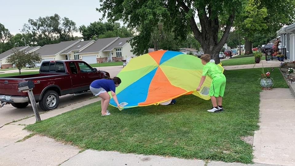 Up, up, and away! Leisa's kiddos had outdoor fun when Rooted gave them a parachute!