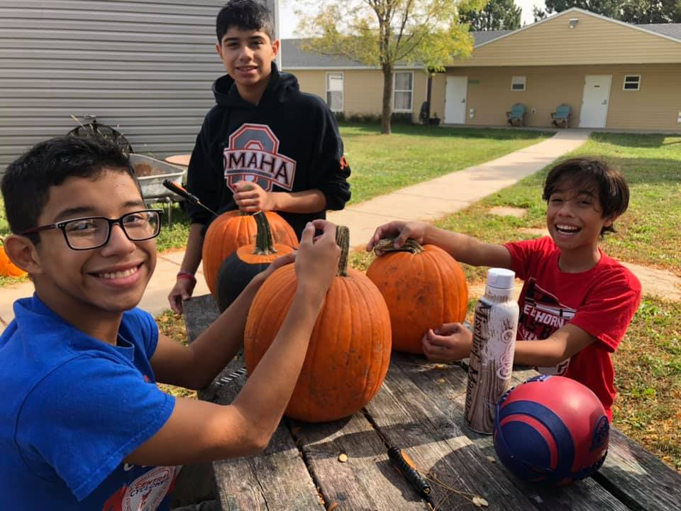 One of the most memorable parts of fall camp: when siblings carved pumpkins together!