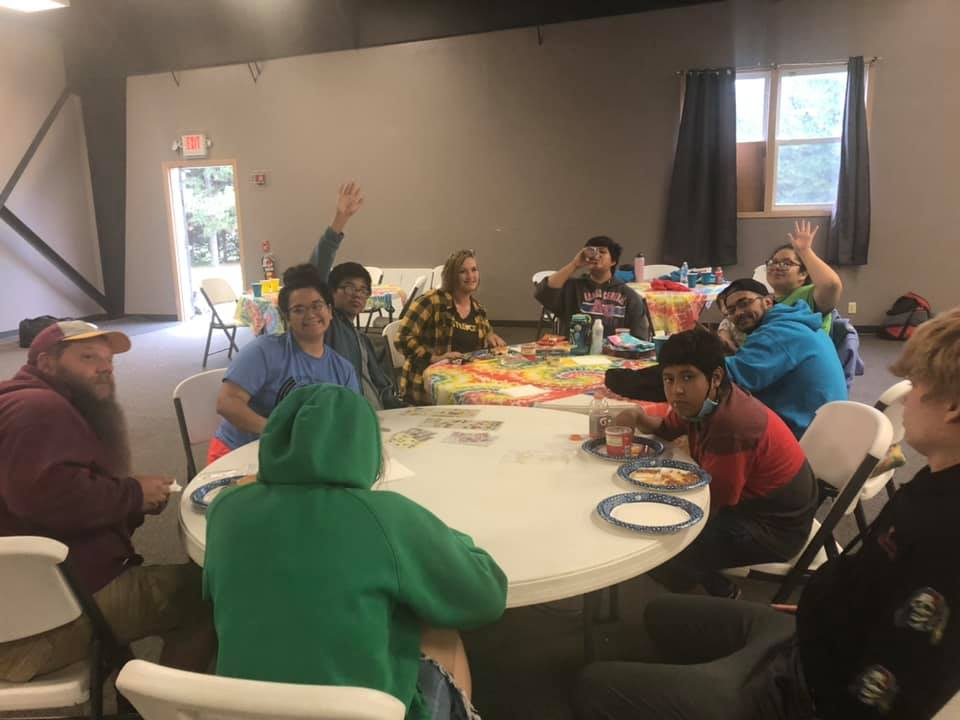 Pandemic or not: at Camp Solaris' fall session. campers have a blast tie-dying and making photo albums to share memories of their sibling reunion!