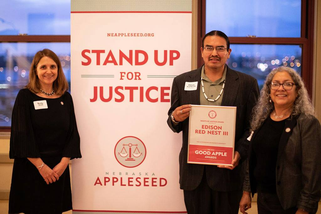 Edison (middle) is a symbol of hope and a role model for Alliance! Here he's just received the Nebraska Appleseed Good Apple Award, which celebrates inspiring community partners.