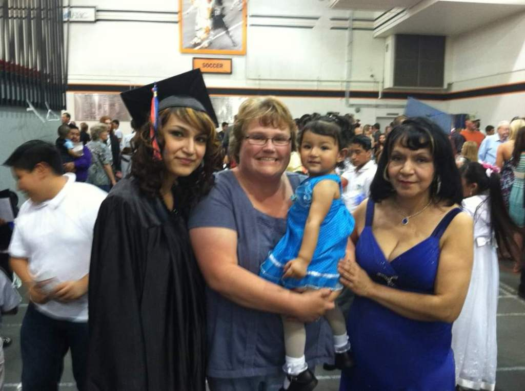 Yecenia achieved her goal: she graduated high school! Here, she poses with (l to r) her Sixpence home visitor, daughter, and mother.