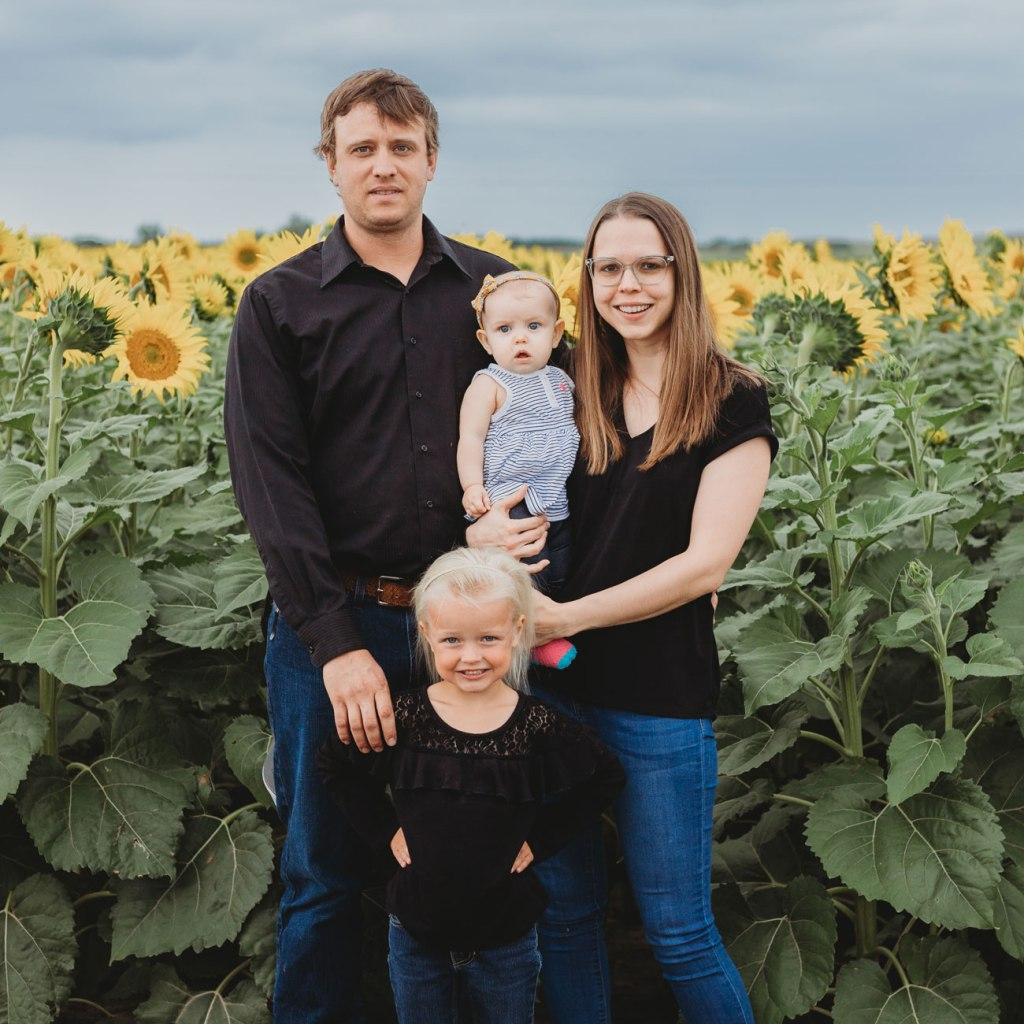 Kristina Foth (right) with her family. Kristina's undergone her own struggles to find childcare. She now dedicates her time and talents to helping others address their own childcare difficulties.