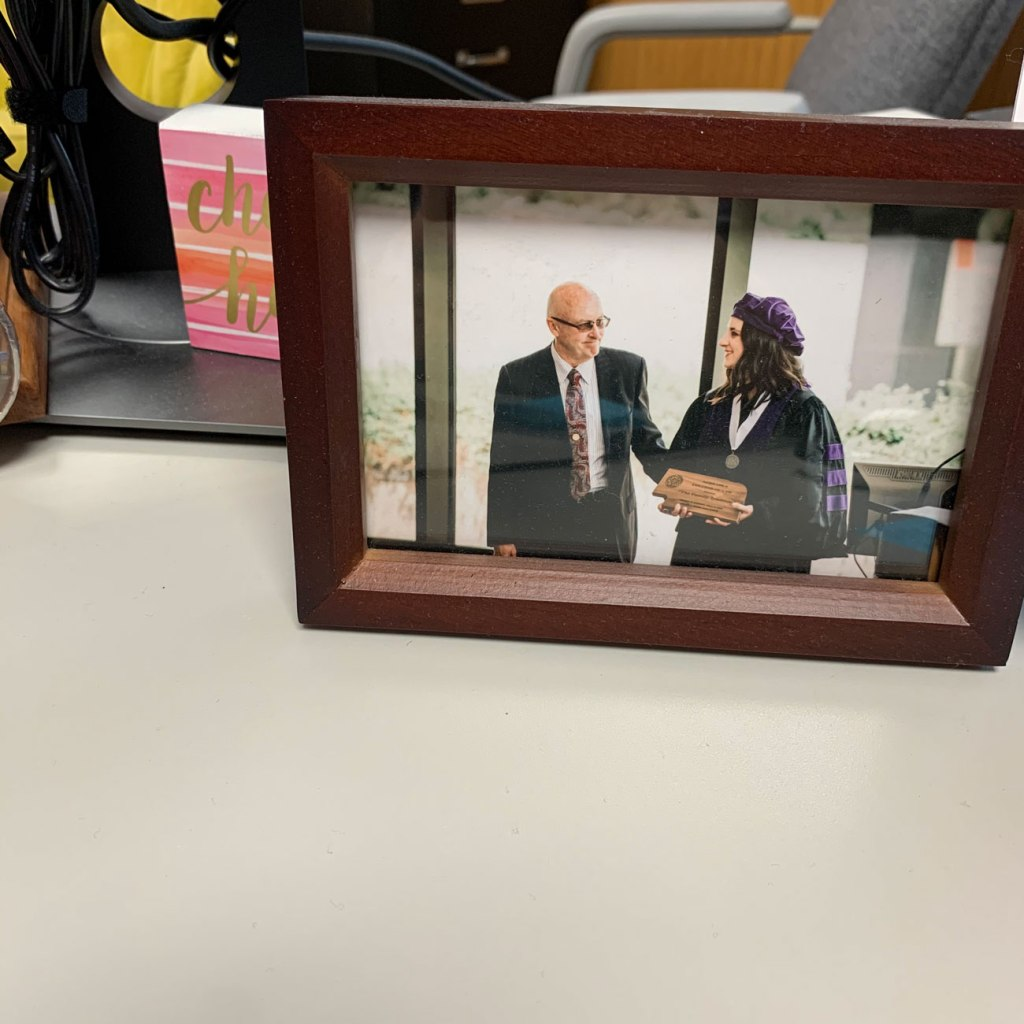 Melani (right) keeps her friends close and her relatives even closer! Here's a graduation picture of Melani with her grandfather, who works at the same law firm that she does!