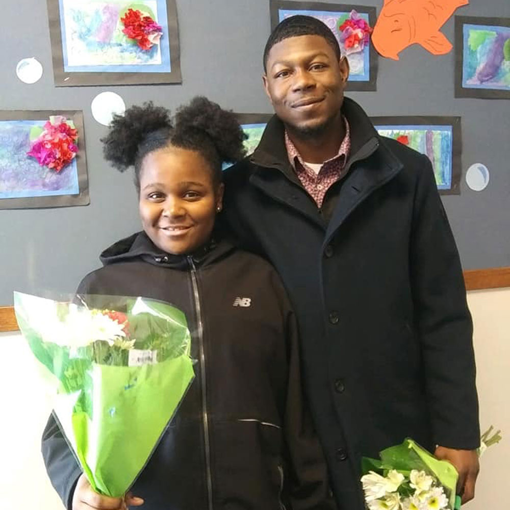 A win-win: shortly after Braxton witnessed the positive influence he had on his afterschool students, he realized that the effect was mutual and far-reaching! Here he is (r) with his cousin.