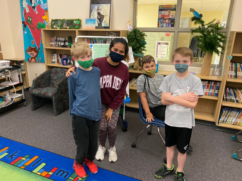 The power of collaboration: UNL Honors student, Sejal Soni, (middle) poses with her elementary-age afterschool students. Sejal has also worked as an ACTivate mentor for GIPS students.