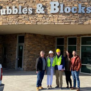 Here is Cory Quimby (r) with his business partner and wife next to him outside of one of their locations.